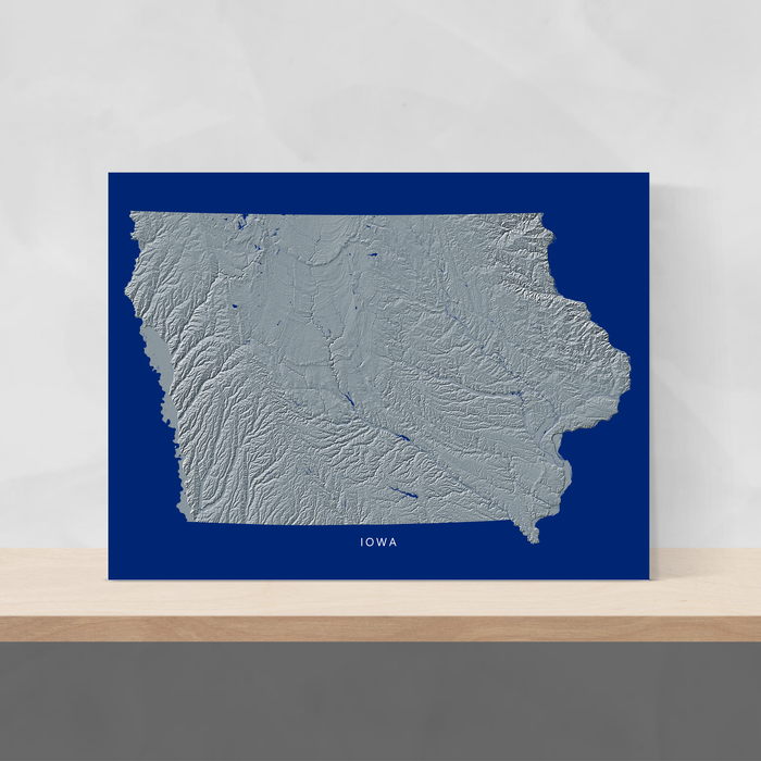 Iowa state map print with natural landscape in greyscale and a navy blue background designed by Maps As Art.