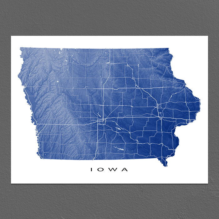 Iowa state map print with natural landscape and main roads in Navy designed by Maps As Art.