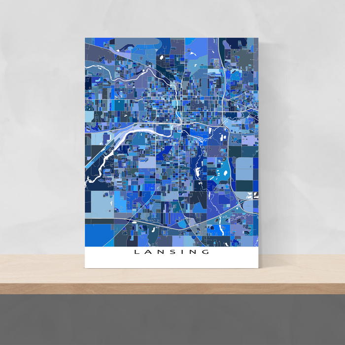 Lansing, Michigan map art print in blue shapes designed by Maps As Art.