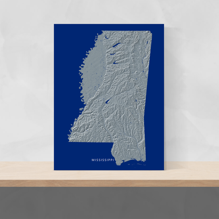 Mississippi state map print with natural landscape in greyscale and a navy blue background designed by Maps As Art.
