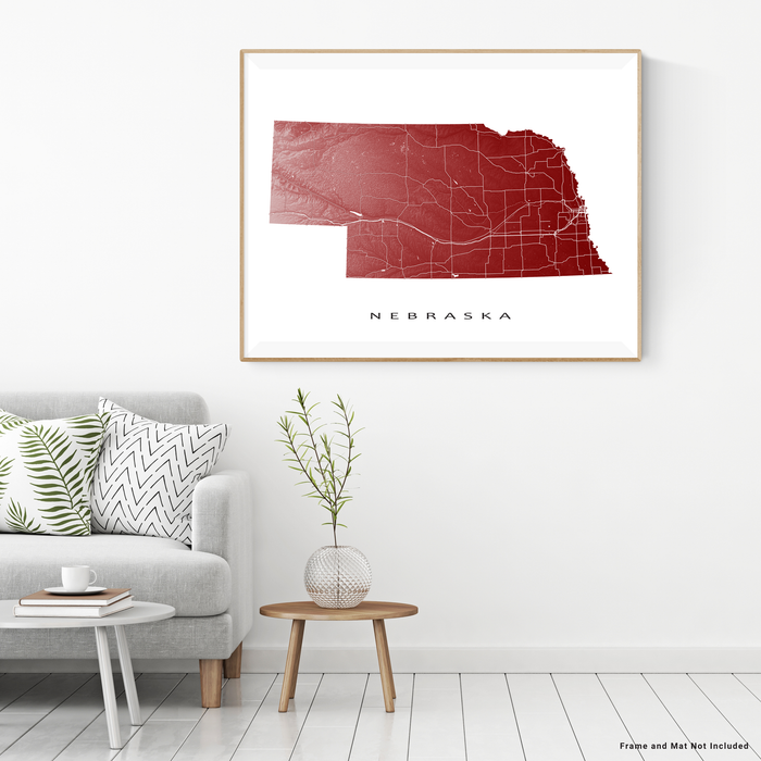 Nebraska state map print with natural landscape and main roads in Merlot designed by Maps As Art.
