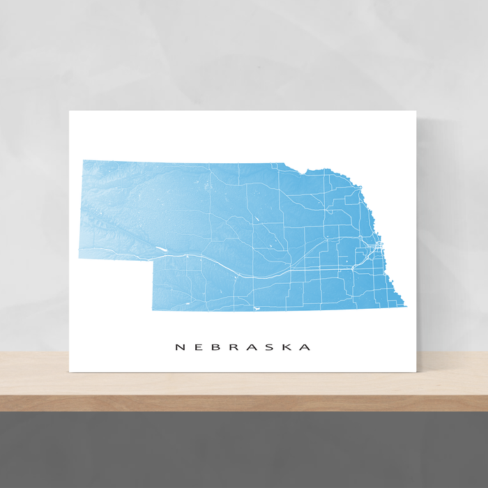 Nebraska state map print with natural landscape and main roads in Malibu designed by Maps As Art.