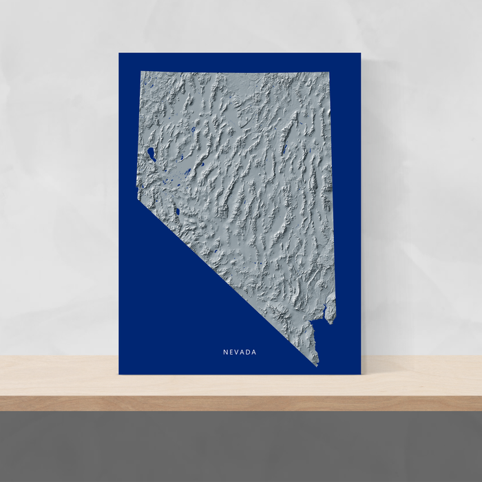 Nevada state map print with natural landscape in greyscale and a navy blue background designed by Maps As Art.