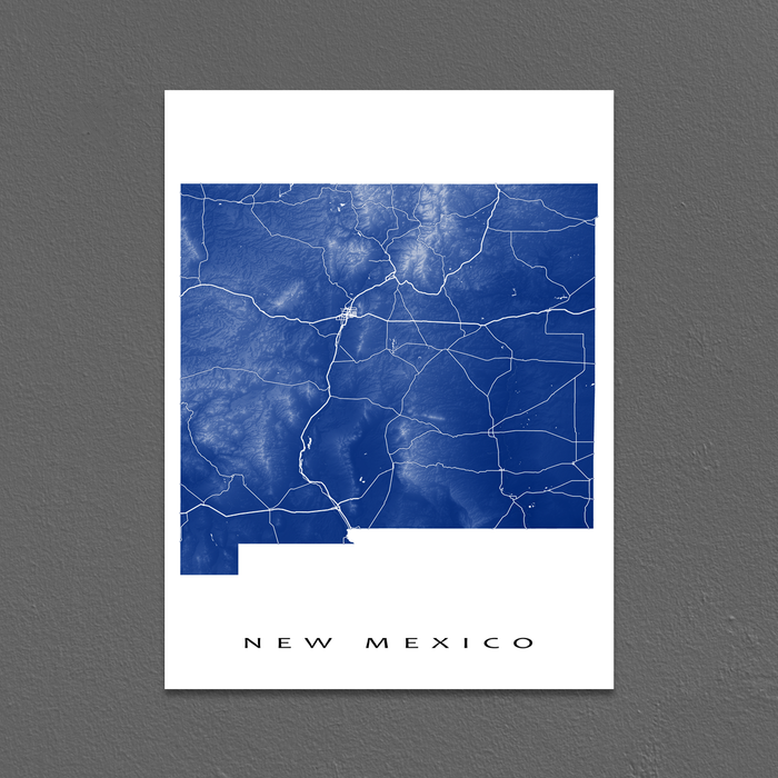 New Mexico state map print with natural landscape and main roads in Navy designed by Maps As Art.