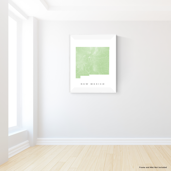 New Mexico state map print with natural landscape and main roads in Sage designed by Maps As Art.
