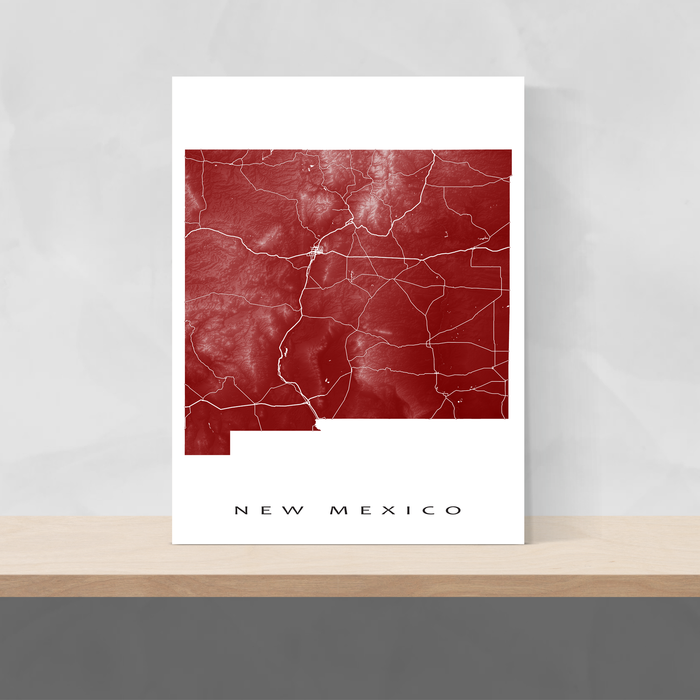 New Mexico state map print with natural landscape and main roads in Merlot designed by Maps As Art.