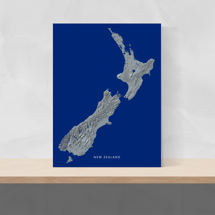 New Zealand map print with natural landscape in greyscale and a navy blue background designed by Maps As Art.