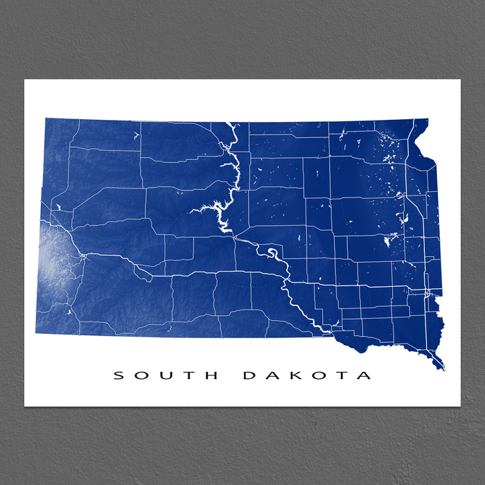 South Dakota state map print with natural landscape and main roads in Navy designed by Maps As Art.
