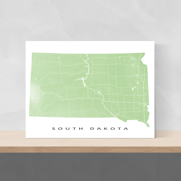 South Dakota state map print with natural landscape and main roads in Sage designed by Maps As Art.