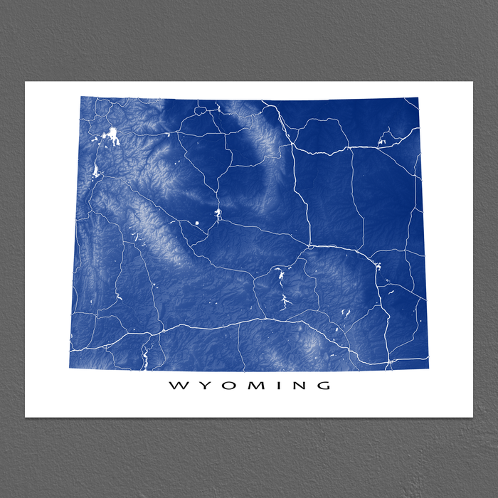 Wyoming map print with natural landscape and main roads in Navy designed by Maps As Art.