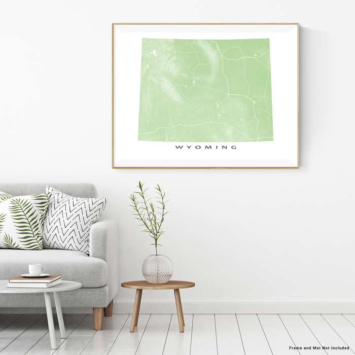 Wyoming map print with natural landscape and main roads in Sage designed by Maps As Art.