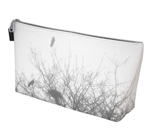 Protected makeup Bags featuring printed artwork by Roxy Hurtubise.