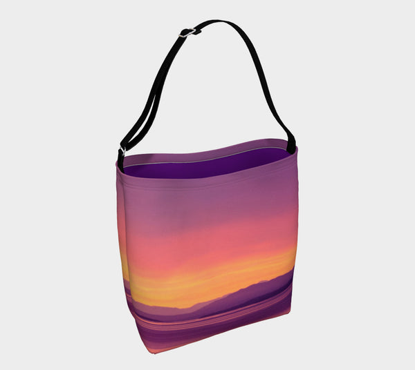 Vancouver Island Sunset Day Tote  Everyday Day Tote for Everything!  Van Isle Goddess ultimate tote bag!   Adjustable strap for comfort, the tote is made from soft and supple neoprene that stretches to fit whatever you can put in it!    Vibrant artwork that will never fade with washing.  Vancouver Island Sunset Artwork by  Roxy Hurtubise with purple interior.