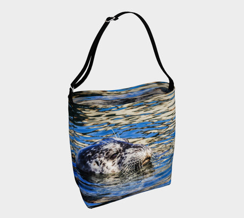 Seal of Blue Day Tote  Everyday Day Tote for Everything!  Van Isle Goddess ultimate tote bag!   Adjustable strap for comfort, the tote is made from soft and supple neoprene that stretches to fit whatever you can put in it!    Vibrant artwork that will never fade with washing.  Seal of Blue Artwork by  Roxy Hurtubise with blue interior.