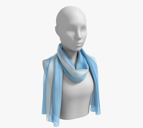 "Ocean Blue Long Scarf  Wear as a scarf, shawl or as a head wrap.  Use for home decor as a wall hanging, also makes fabulous Wedding Party Gifts!    Artwork printed on 100% polyester lightweight fabric.    Choose from three different fabrics polychiffon, satin charmeuse and matte crepe.    Machined baby rolled edge hem finish.  Choose from 2 sizes:    10"" x 45""    16"" x 72"" by Roxy Hurtubise vanislegoddess.com"