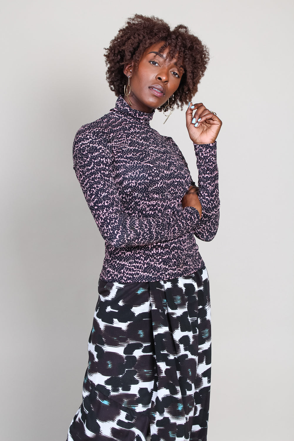 Telar Turtleneck in Pink/Black Snake
