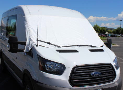 Transit van with cab window cover installed