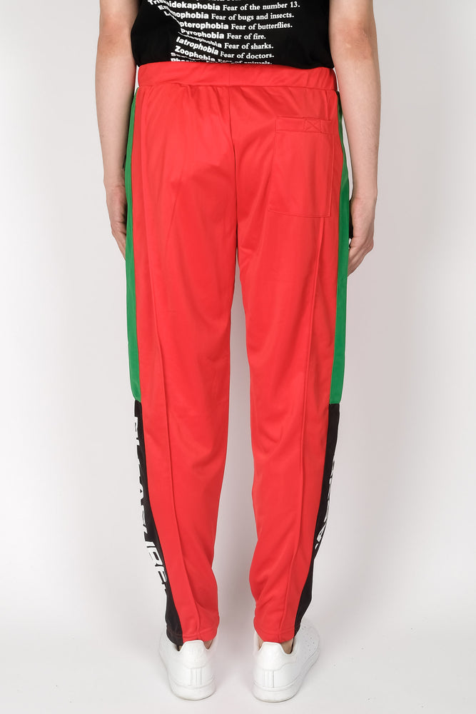 PLEASURES Colorblock Track Pant In Red - CNTRBND