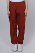 A Cold Wall Overlock Nylon Trousers In Rust - CNTRBND