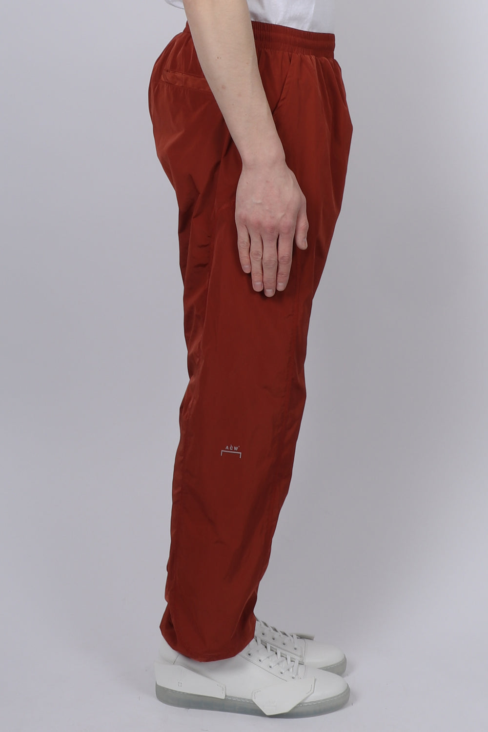 A Cold Wall Overlock Nylon Trousers In Rust