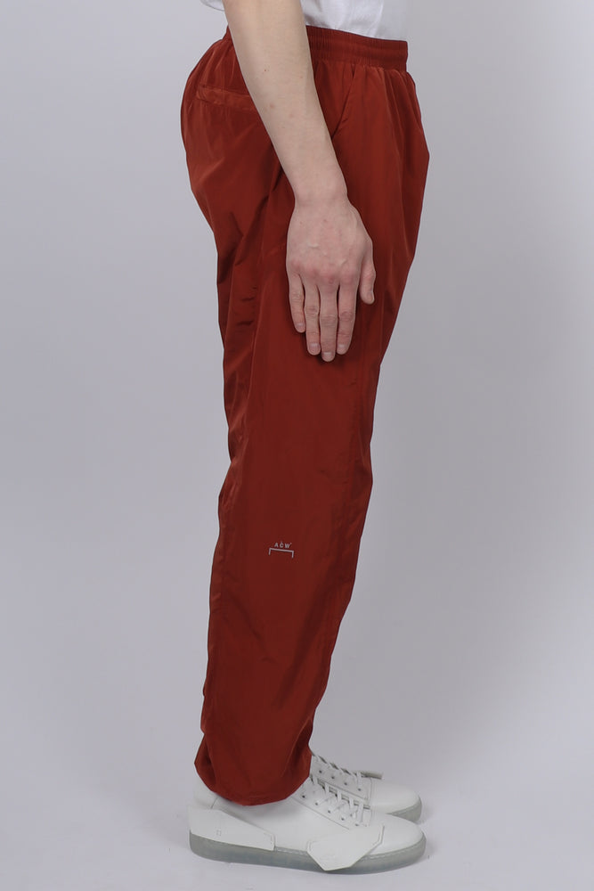 Load image into Gallery viewer, A Cold Wall Overlock Nylon Trousers In Rust