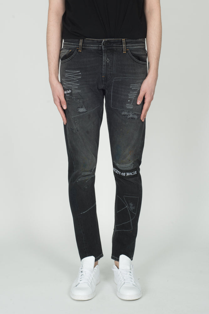 Marcelo Burlon Gothic Surfer Antifit Jeans In Vintage Wash - CNTRBND