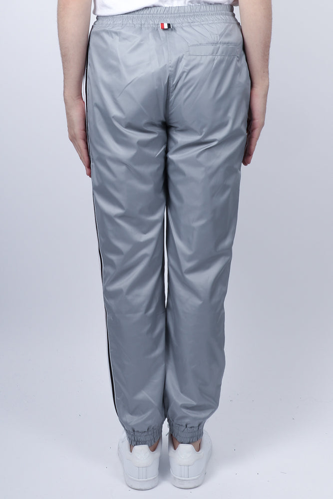 Load image into Gallery viewer, Thom Browne RWB Stripe Ripstop Track Pants In Lt Grey - CNTRBND