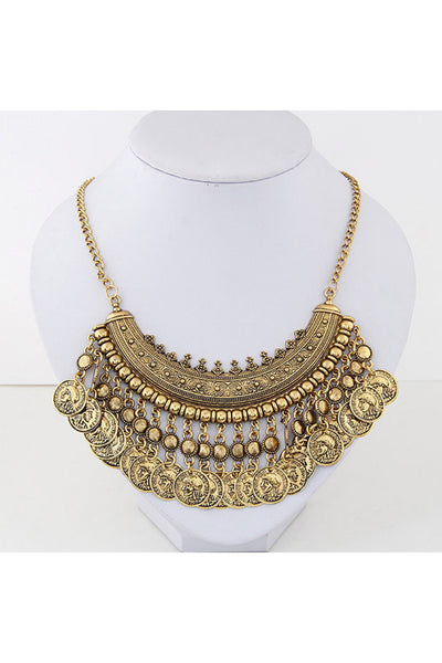 Bohemian Style Coin Necklace in antique gold finish with intricate details is shown on jewelry display