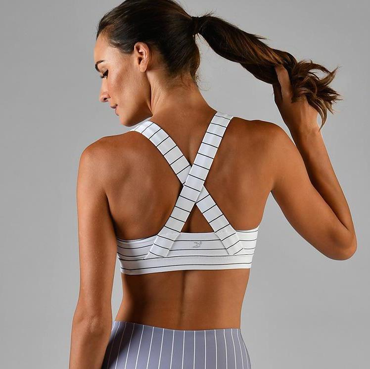 glyder apparel define sports bra in pinstripe black and white