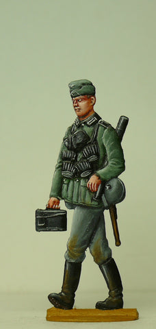 Soldier loaded with ammo and spare barrel for MG42