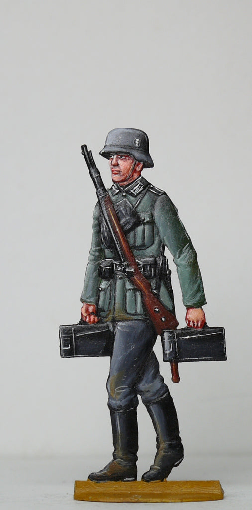 Soldier carrying ammo boxes