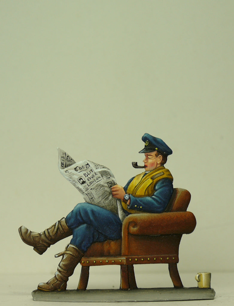 fighter pilot on sofa reading newspaper