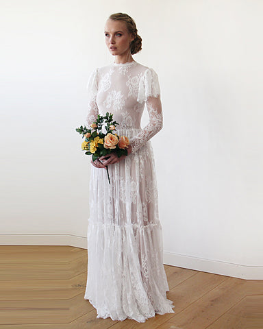 ced22a3e03ecc The perfect way to achieve this look is with the Woodland Wedding Dress  from Blushfashion that features layered sleeves in vintage lace.