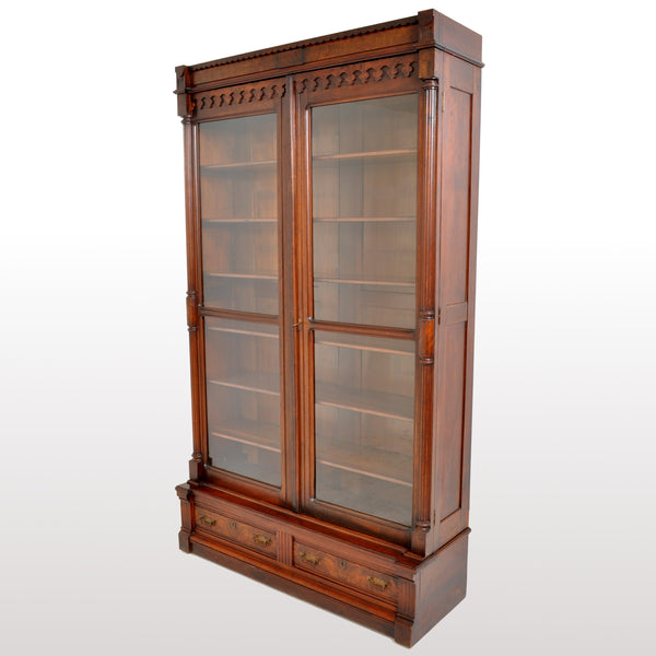 Antique American Renaissance Revival Eastlake Carved Walnut Tall Bookcase, circa 1875