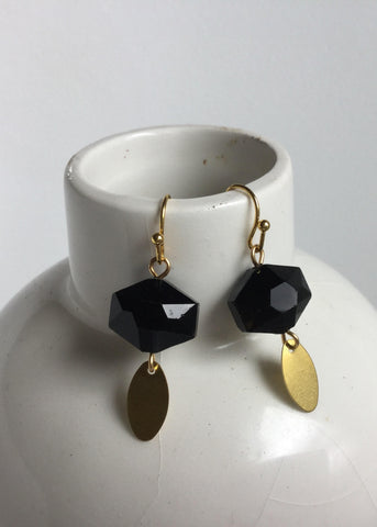 Black hexagon with gold drop