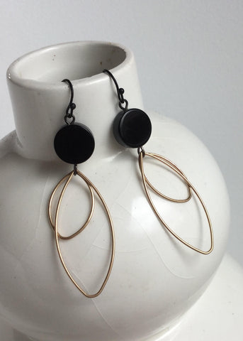 black stone with oval drops