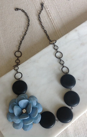 Turquoise flower with black stone