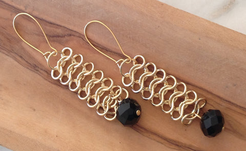 Gold chain with facet black stone