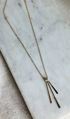Gold paddle necklace