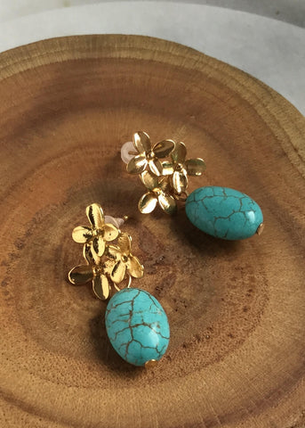 gold flower with turquoise drop