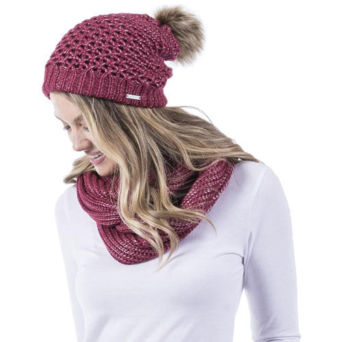 red knitted pom pom beanie and scarf