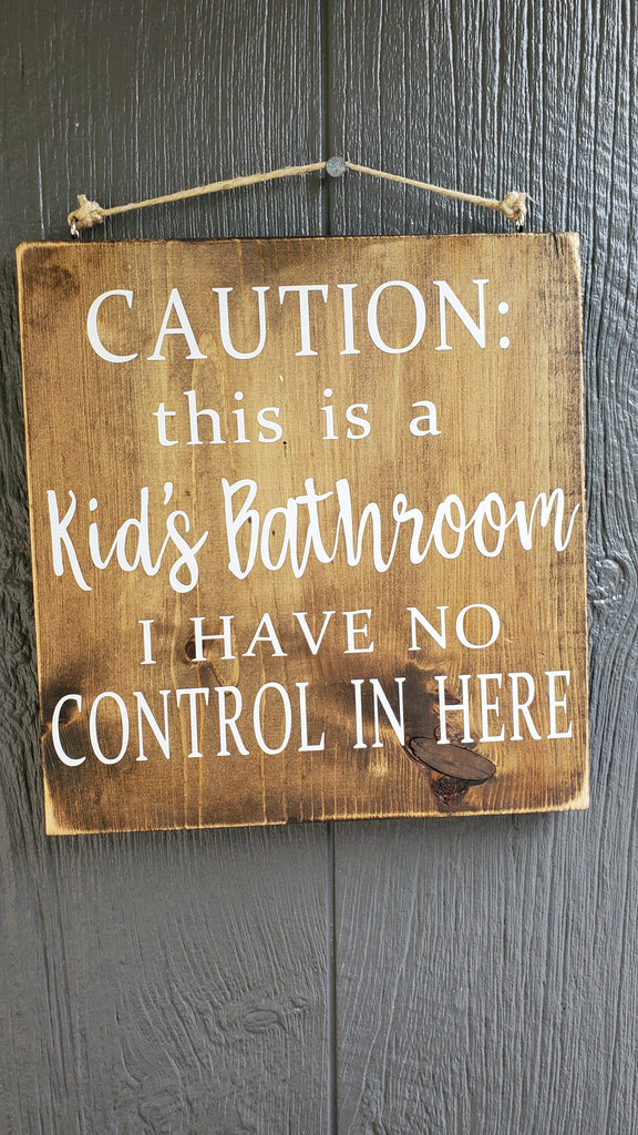 Caution:  This is a kids bathroom.  I have no contol in here.  wood sign