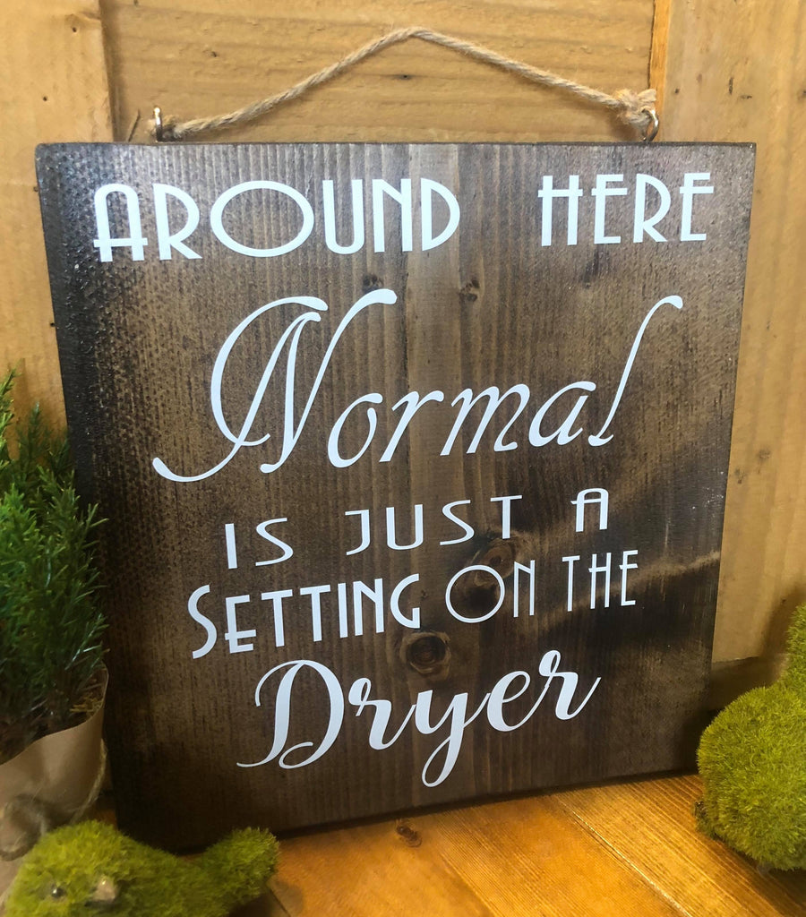 Around here normal is just a setting on the dryer wood sign