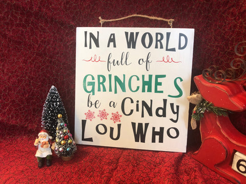 In a world full of grinches wood sign