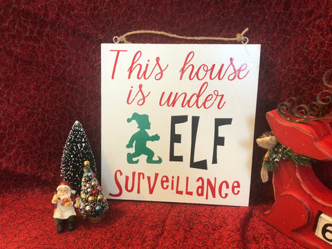 This house under Elf surveillance wood sign