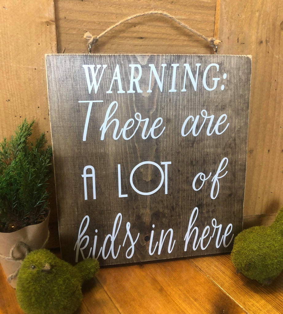 Warning:  There are a lot of kids in here wood sign