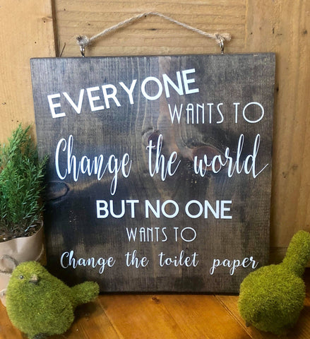 Everyone wants to change the world... Wood sign