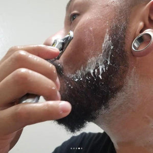 Dave shaving around his beard to give it a clean look.