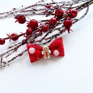 A Red Mini Gingerbread Man Pominnie Bow