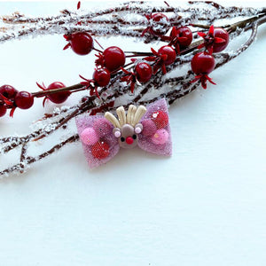 A Pink Mini Reindeer Pominnie Bow